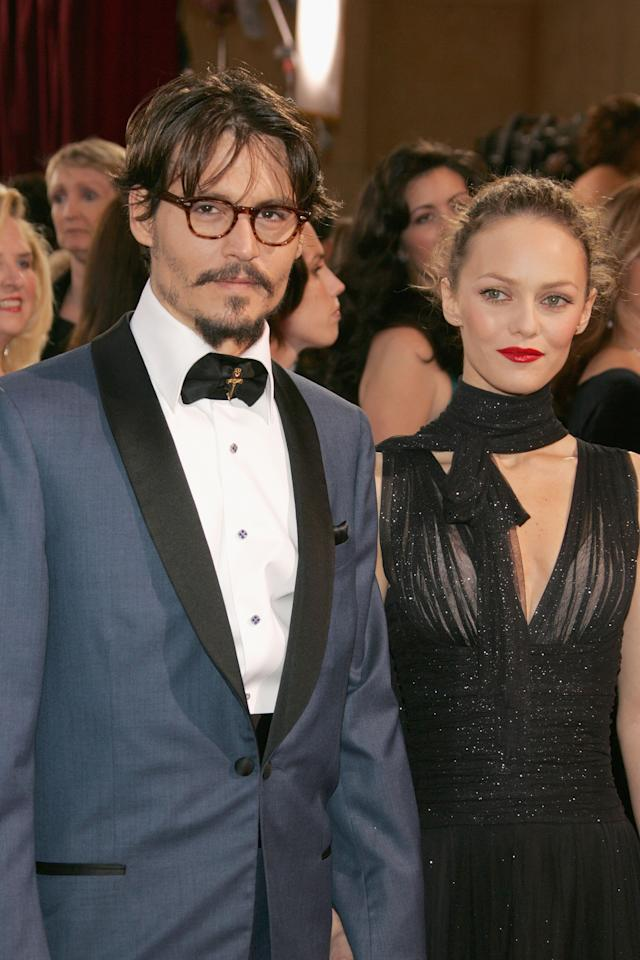 HOLLYWOOD, CA - FILE:  Actor Johnny Depp and his partner Vanessa Paradis arrive at the 77th Annual Academy Awards at the Kodak Theater on February 27, 2005 in Hollywood, California.  According to reports June 19, 2012 Johnny Depp and Vanessa Paradis have separated.  (Photo by Vince Bucci/Getty Images)