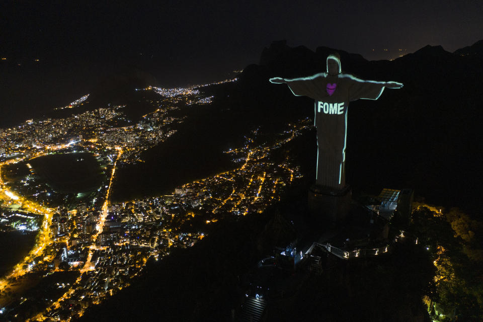 "The Portuguese word ""Hunger"" is projected over the Rio's Christ the Redeemer statue amid the new coronavirus outbreak in Rio de Janeiro, Brazil, Sunday, May 10, 2020. (AP Photo/Leo Correa)"