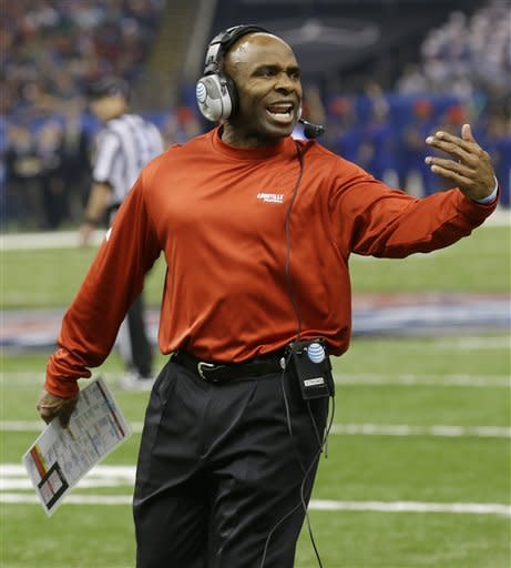 Louisville head coach Charlie Strong talks with his players in the first half against Florida in the Sugar Bowl NCAA college football game Wednesday, Jan. 2, 2013, in New Orleans. (AP Photo/Bill Haber)