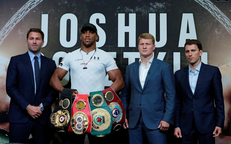 Anthony Joshua is defending all four of his world title belts against Alexander Povetkin on Saturday  - Getty Images