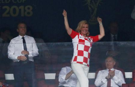 Soccer Football - World Cup - Final - France v Croatia - Luzhniki Stadium, Moscow, Russia - July 15, 2018  President of Croatia Kolinda Grabar-Kitarovic celebrates after Croatia's first goal as President of France Emmanuel Macron and President of Russia Vladimir Putin look on   REUTERS/Damir Sagolj