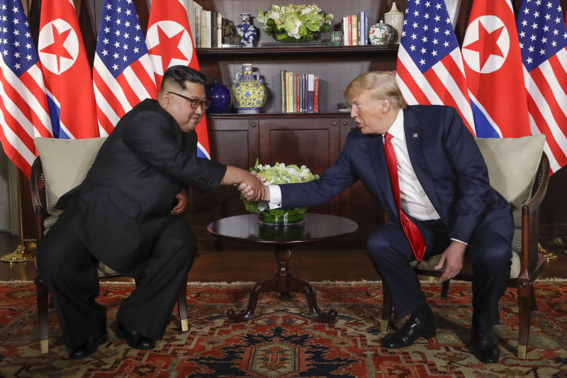 FILE - In this June 12, 2018, file photo, North Korea leader Kim Jong Un, left, and U.S. President Donald Trump shake hands during their first meeting at the Capella resort on Sentosa Island in Singapore. Vietnam's selection as the venue for the second summit meeting of them is largely a matter of convenience and security, but not without bigger stakes. (AP Photo/Evan Vucci, File)