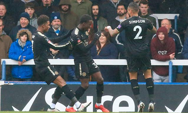 Fousseni Diabaté (centre) celebrates putting Leicester 1-0 up in their FA Cup fourth-round tie at Peterborough. He also scored their fourth.