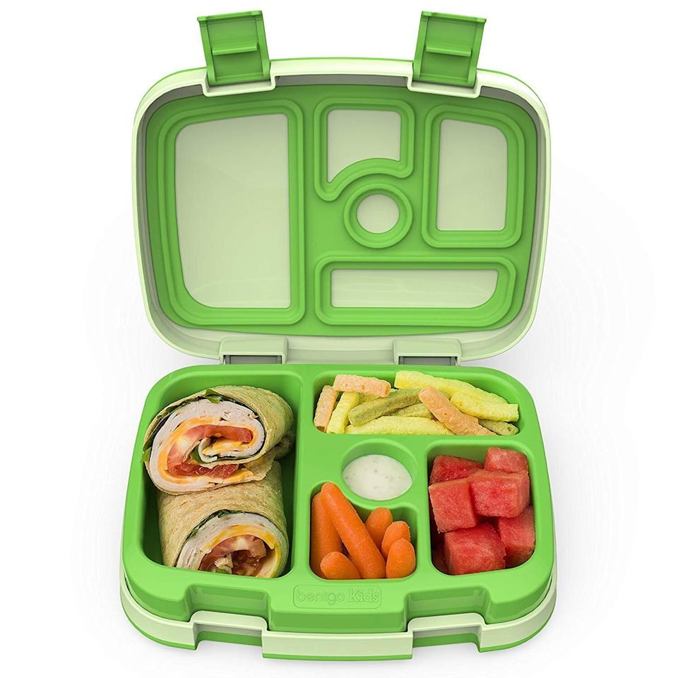 """This five compartment bento-style food container is leakproof and dishwasher safe. <strong><a href=""""https://amzn.to/2YOWHhx"""" target=""""_blank"""" rel=""""noopener noreferrer"""">Find theBentgo Kids Childrens Lunch Box for $28 on Amazon</a></strong>."""