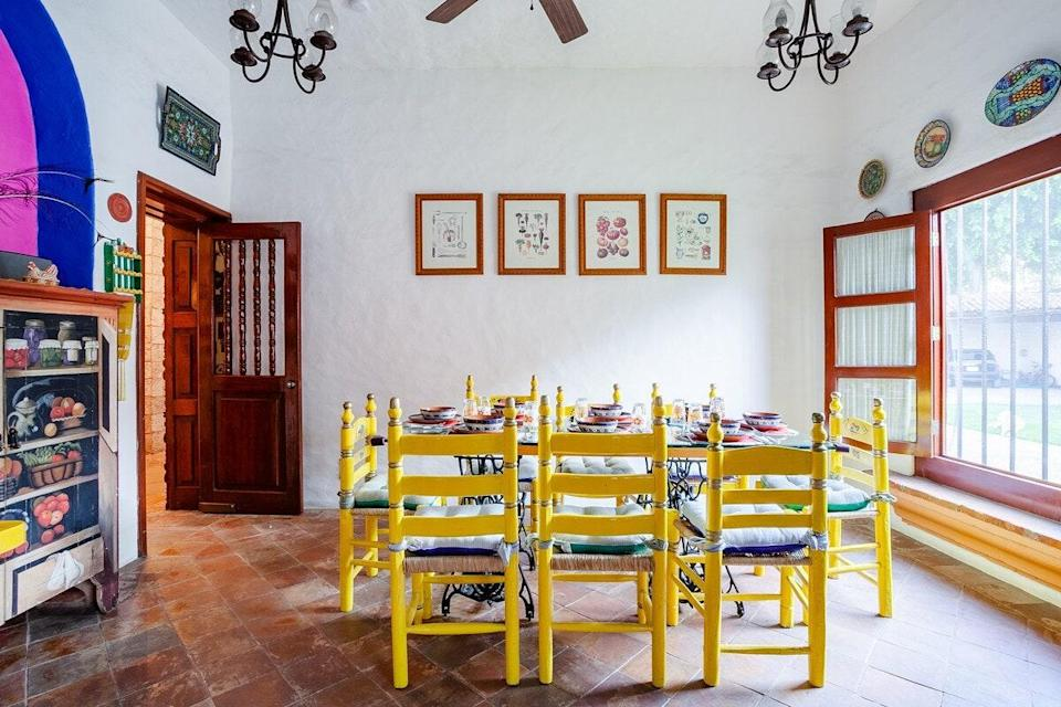 "<p>This may be one of the most colorful Airbnbs on this list, between the fluorescent yellow dining chairs, blue and hot pink accent wall, sea-green bathroom, and completely Talavera-tiled kitchen. But there are more subdued places to relax in this two-bedroom, too. Well, technically, the pool and stunning courtyard are outside, but they're still within property lines. Use this as a base to explore Jiutepec and nearby <a href=""https://www.cntraveler.com/stories/2015-12-31/an-ex-pats-guide-to-cuernavaca-mexico?mbid=synd_yahoo_rss"" rel=""nofollow noopener"" target=""_blank"" data-ylk=""slk:Cuernavaca"" class=""link rapid-noclick-resp"">Cuernavaca</a>. </p> <p><strong>Book now:</strong> <a href=""https://airbnb.pvxt.net/KnYVa"" rel=""nofollow noopener"" target=""_blank"" data-ylk=""slk:From $118 per night, airbnb.com"" class=""link rapid-noclick-resp"">From $118 per night, airbnb.com</a> </p>"