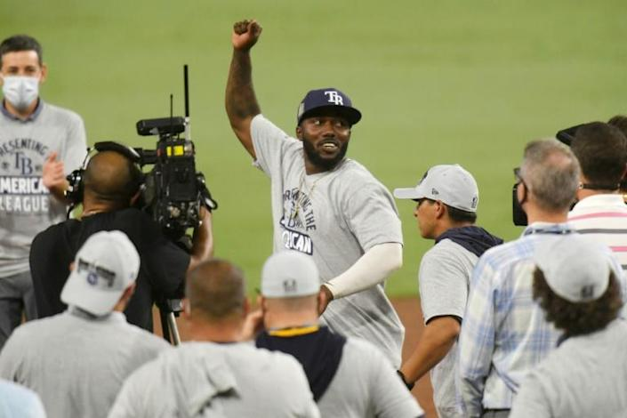 Tampa Bay Rays Randy Arozarena, centre, celebrates being named MVP after beating the Houston Astros 4-2