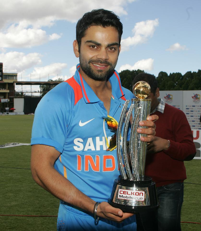 Indian captain Virat Kohli holds the Celkon Trophy after winning the final game of the 5 match cricket ODI series between hosts Zimbabwe and India at Queens Sports Club on August 3, 2013. AFP PHOTO /Jekesai Njikizana.        (Photo credit should read JEKESAI NJIKIZANA/AFP/Getty Images)