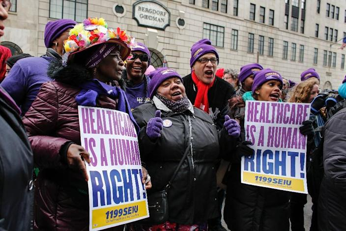 """Activists protest during the """"March for Health"""" demanding equitable and affordable access to quality healthcare, in April 2017, in New York (AFP Photo/KENA BETANCUR)"""