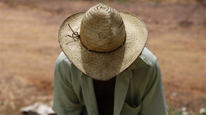 A man sits in the village of Areias in Trairao, state of Para, May 27, 2012.