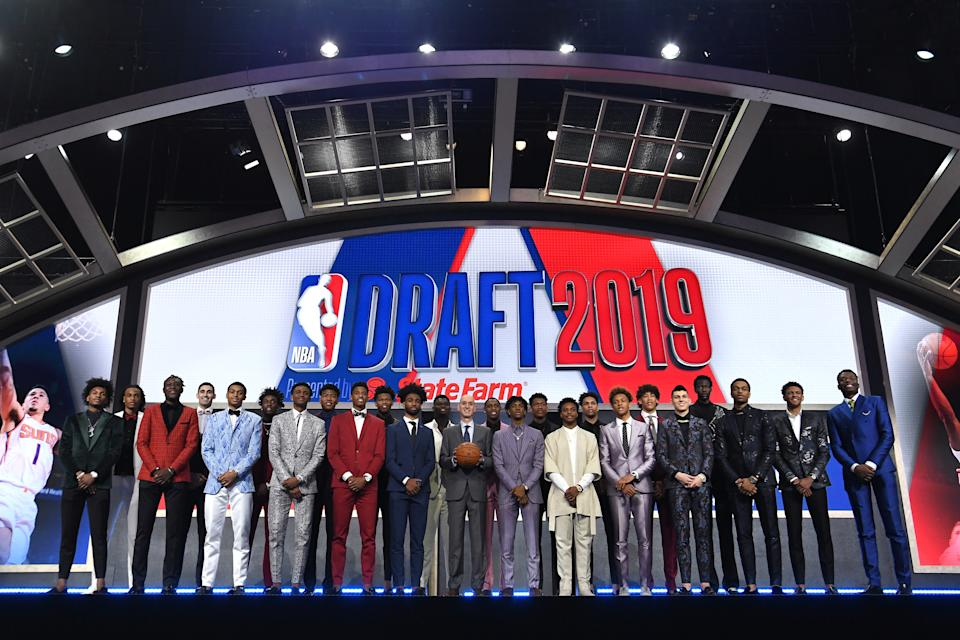 NBA Draft prospects Kevin Porter Jr., Nicolas Claxton, Sekou Doumbouya, Goga Bitazde, Keldon Johnson, Nassir Little, Nickeil Alexander-Walker, Rui Hachimuri, Jarrett Culver, Cam Reddish, Coby White, Zion Williamson, NBA Commissioner Adam Silver, Ja Morant, De'Andre Hunter, Darius Garland, Brandon Clarke, Romeo Langford, Jaxson Hayes, Tyler Herro, Bol Bol, PJ Washington, Matisse Thybulle and Mfiondu Kabengele stand on stage with NBA Commissioner Adam Silver before the start of the 2019 NBA Draft.