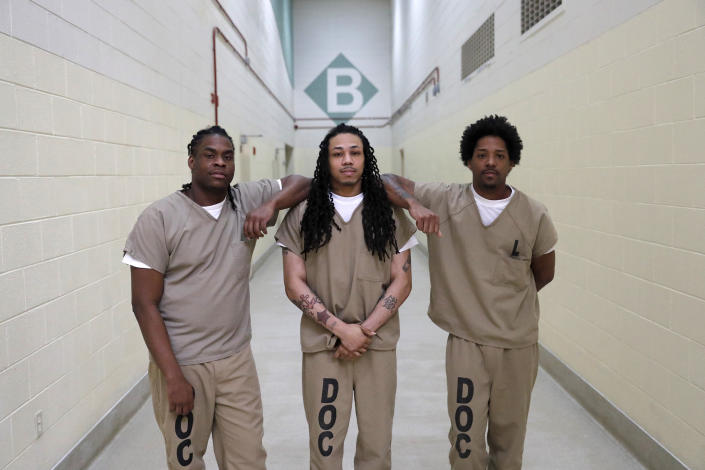 """Inmates at the Cook County Jail Joshua Cavin, Sean Allen and Sirjerathan Wilson pose for a portrait outside cell pod """"B"""" after participating in early voting for the Illinois primary in Chicago on March 12, 2020.<span class=""""copyright"""">Charles Rex Arbogast—AP</span>"""
