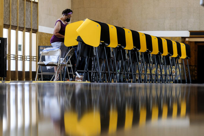 A voter casts a ballot for the California recall election at a vote center at Union Station, Tuesday, Sept. 14, 2021, in Los Angeles. (AP Photo/Ringo H.W. Chiu)