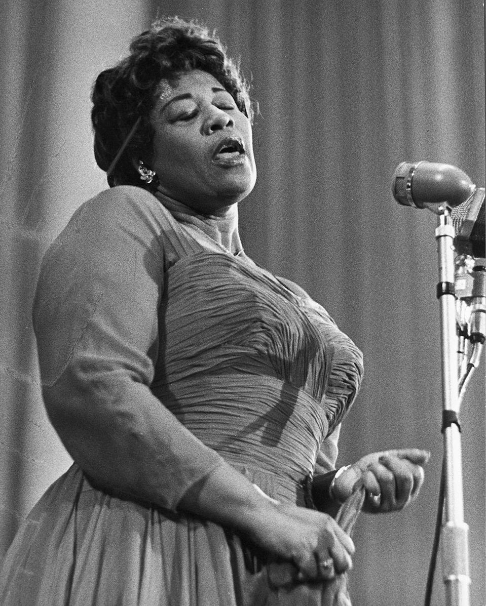 """<p>One of the most famous jazz singers in history, Ella Fitzgerald made a name for herself with her incredible vocal range and collaborations with musicians like Louis Armstrong (on an <a href=""""https://www.youtube.com/watch?v=uEb4HzgILUU"""" rel=""""nofollow noopener"""" target=""""_blank"""" data-ylk=""""slk:entire duet album"""" class=""""link rapid-noclick-resp"""">entire duet album</a> in 1956.) Fitzgerald regularly made her performances feel extra special and formal by wearing costume jewelry and full-length gowns.<i> (Photo: Getty Images)</i></p>"""