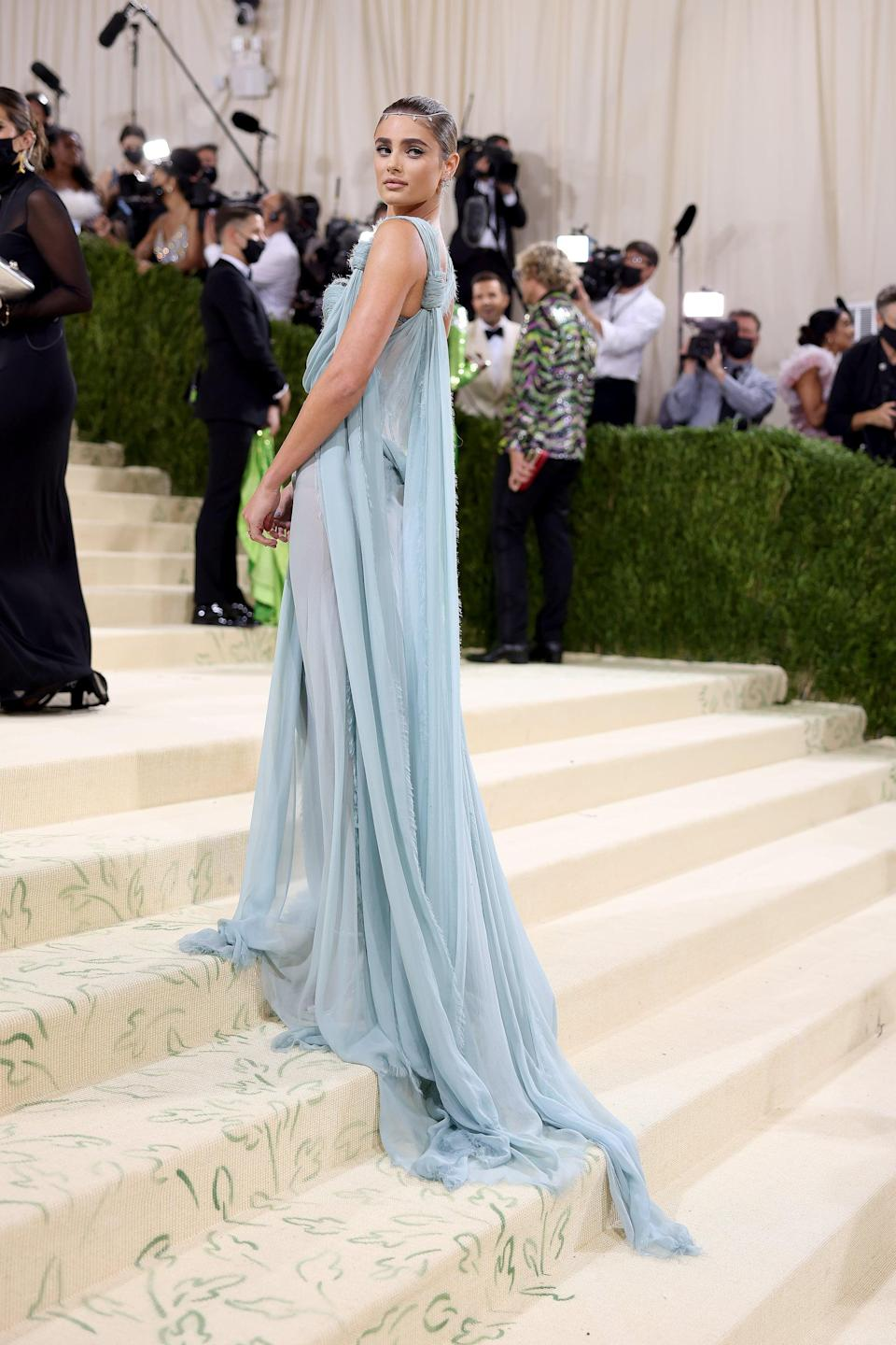 <p>Wearing an Atelier Versace Couture dress.</p>