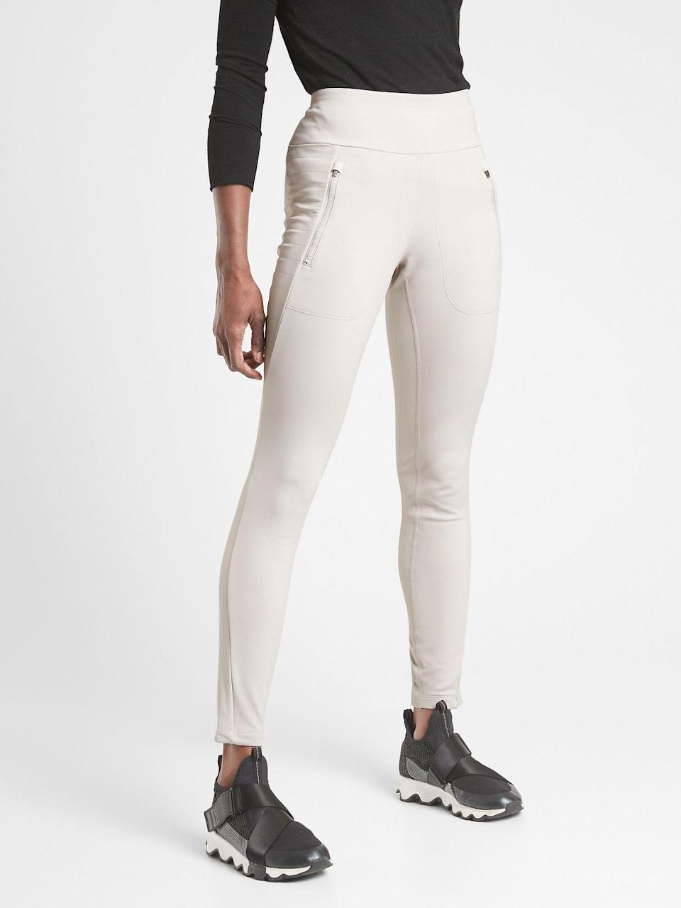 """<p><strong>Athleta</strong></p><p>athleta.gap.com</p><p><strong>$108.00</strong></p><p><a href=""""https://go.redirectingat.com?id=74968X1596630&url=https%3A%2F%2Fathleta.gap.com%2Fbrowse%2Fproduct.do%3Fpid%3D511126012%26pcid%3D999%26vid%3D1%26searchText%3Dfleece%2Bleggings&sref=https%3A%2F%2Fwww.seventeen.com%2Ffashion%2Fg34440479%2Fbest-winter-leggings%2F"""" rel=""""nofollow noopener"""" target=""""_blank"""" data-ylk=""""slk:Shop Now"""" class=""""link rapid-noclick-resp"""">Shop Now</a></p><p>Perfect for cold weather training, these mid-weight fleece leggings made from recycled nylon will hold you in <em>and</em> keep you warm. Which also makes these ideal for those who just run cold and are searching for a pair of cozy winter leggings to lounge on the couch in.</p>"""