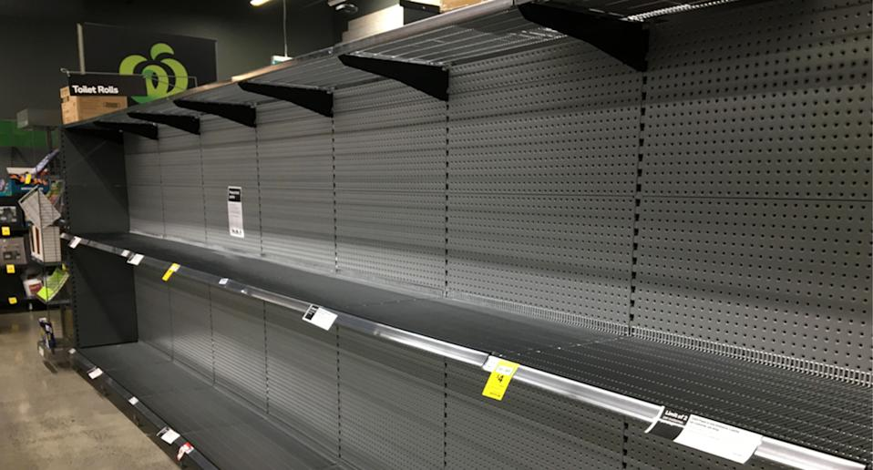 Empty toilet paper shelves in Woolworths.
