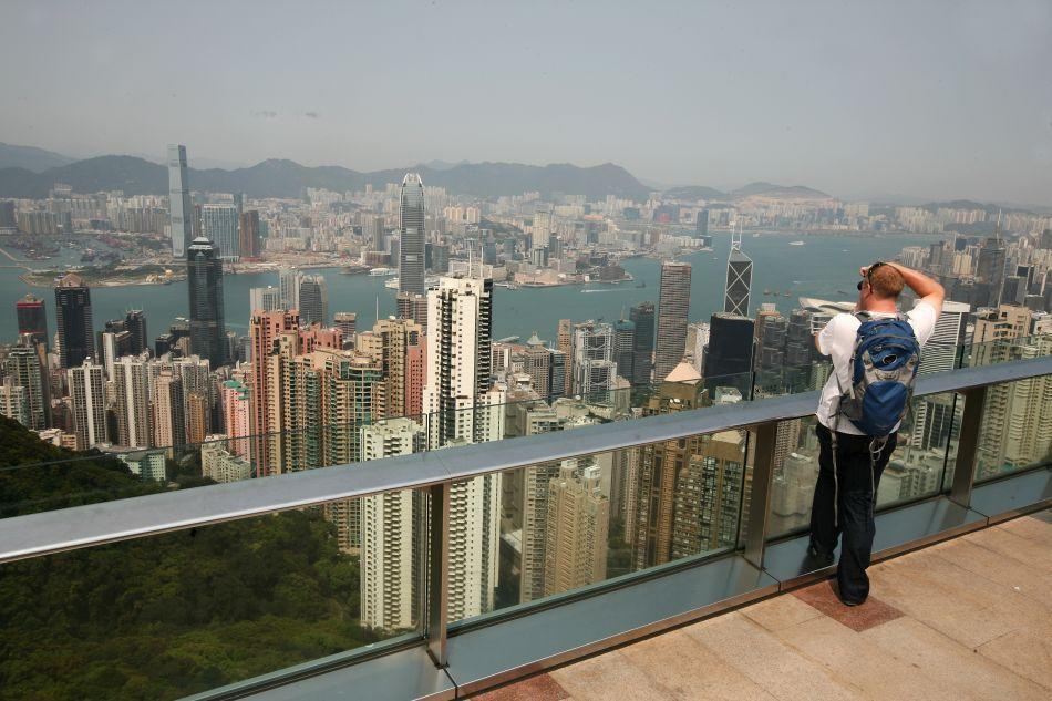 A visitor photographs the view from the Sky Terrace 428.