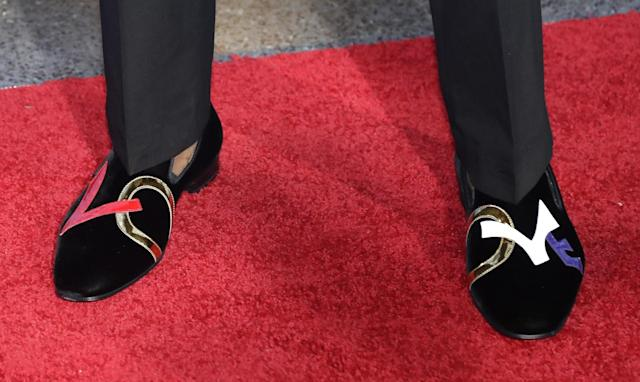 <p>Kentucky's De'Aaron Fox shows off his shoes as he stops for photos while walking the red carpet before the start of the NBA basketball draft, Thursday, June 22, 2017, in New York. (AP Photo/Frank Franklin II) </p>
