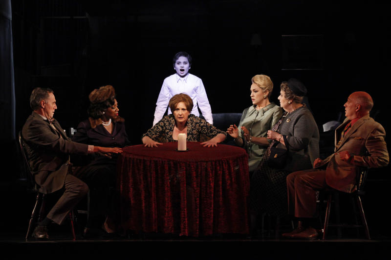 """In this April 15, 2011 photo released by the New York City Opera, cast members of """"Seance on a Wet Afternoon,"""" are seen during a dress rehearsal at the New York City Opera at Lincoln Center in New York. From left are: Boyd Schlaefer; Pamela Jones; Lauren Flanigan;  Michael Kepler Meo in background; Melody Moore; Jane Shaulis and Doug Purcell. (AP Photo/New York City Opera, Carol Rosegg)"""