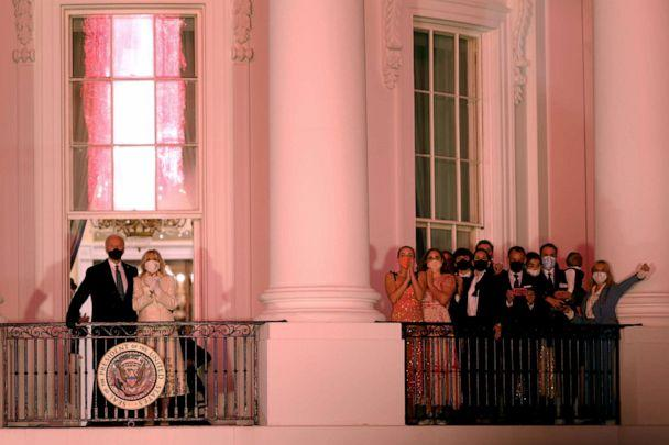 PHOTO: President Joe Biden and First Lady Dr. Jill Biden watch a fireworks display beside family and staff members from the Truman Balcony of the White House in Washington, Jan. 20, 2021. (Tom Brenner/Reuters)