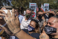 California Gov. Gavin Newsom, middle, takes selfies with supporters at an event against the recall election at the Culver City High School in Culver City, Calif., Saturday, Sept. 4, 2021.