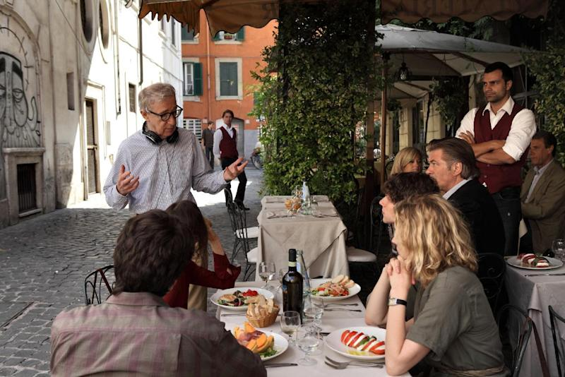 """This film image released by Sony Pictures Classics shows director Woody Allen, standing left, talking with the cast during the filming of """"To Rome With Love."""" """"To Rome With Love"""" is Woody Allen's 45th film, a total the 76-year-old director has amassed by making, with remarkable consistency, a film a year. (AP Photo/Sony Pictures Classics, Philippe Antonello)"""