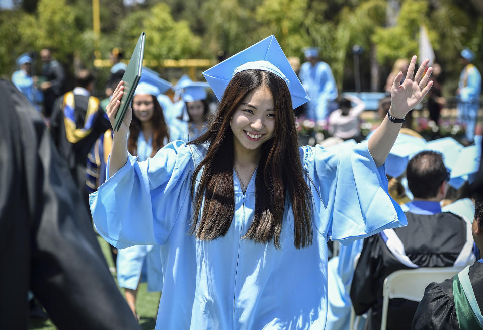 IRVINE, CA - JUNE 07: Graduate Caroline Hong is all smiles after receiving her diploma during the commencement ceremony at Irvine High School in Irvine, CA, on Thursday, June 7, 2018. (Photo by Jeff Gritchen/Digital First Media/Orange County Register via Getty Images)