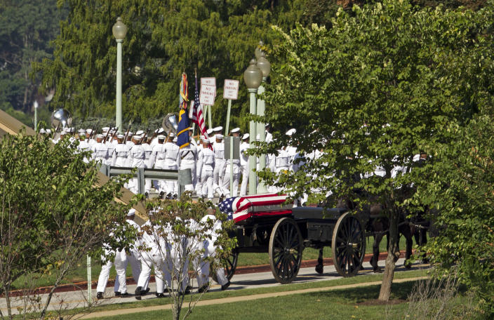 <p> A horse drawn caisson carries the casket containing the remains of Sen. John McCain, R-Ariz., to his burial sight at the United States Naval Academy Cemetery in Annapolis Md., Sunday, Sep. 2, 2018. McCain died Aug. 25 from brain cancer at age 81. (AP Photo/Jose Luis Magana) </p>