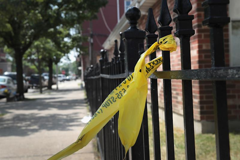 Crime scene tape remains on a fence near Holy Cross Church where Salvador Suarez was gunned down Sunday as services were ending June 20, 2016 in Chicago, Illinois. (Photo: Scott Olson/Getty Images)