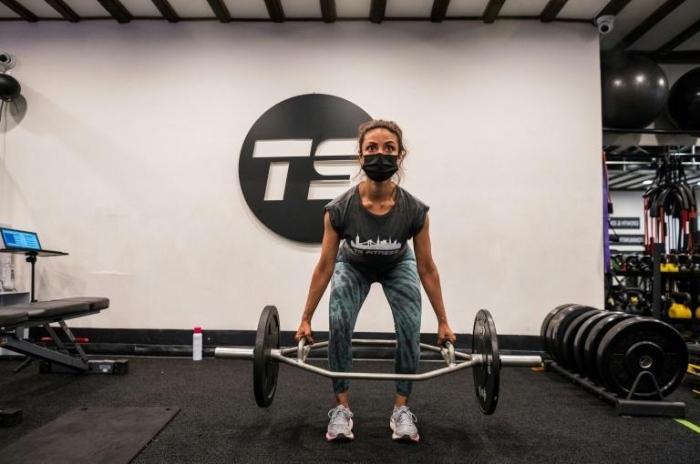 A woman works out at TS Fitness studio in New York