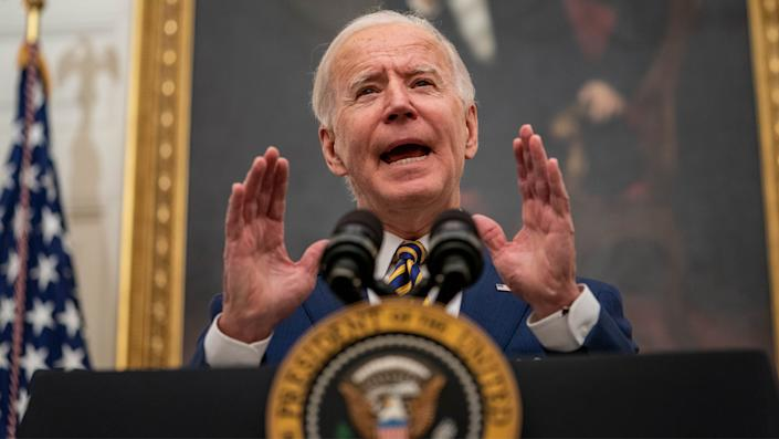 U.S. President Joe Biden speaks on his administrations response to the economic crisis in the State Dining Room of the White House in Washington, D.C., U.S., on Friday, Jan. 22, 2021. (Ken Cedeno/CNP/Bloomberg via Getty Images)