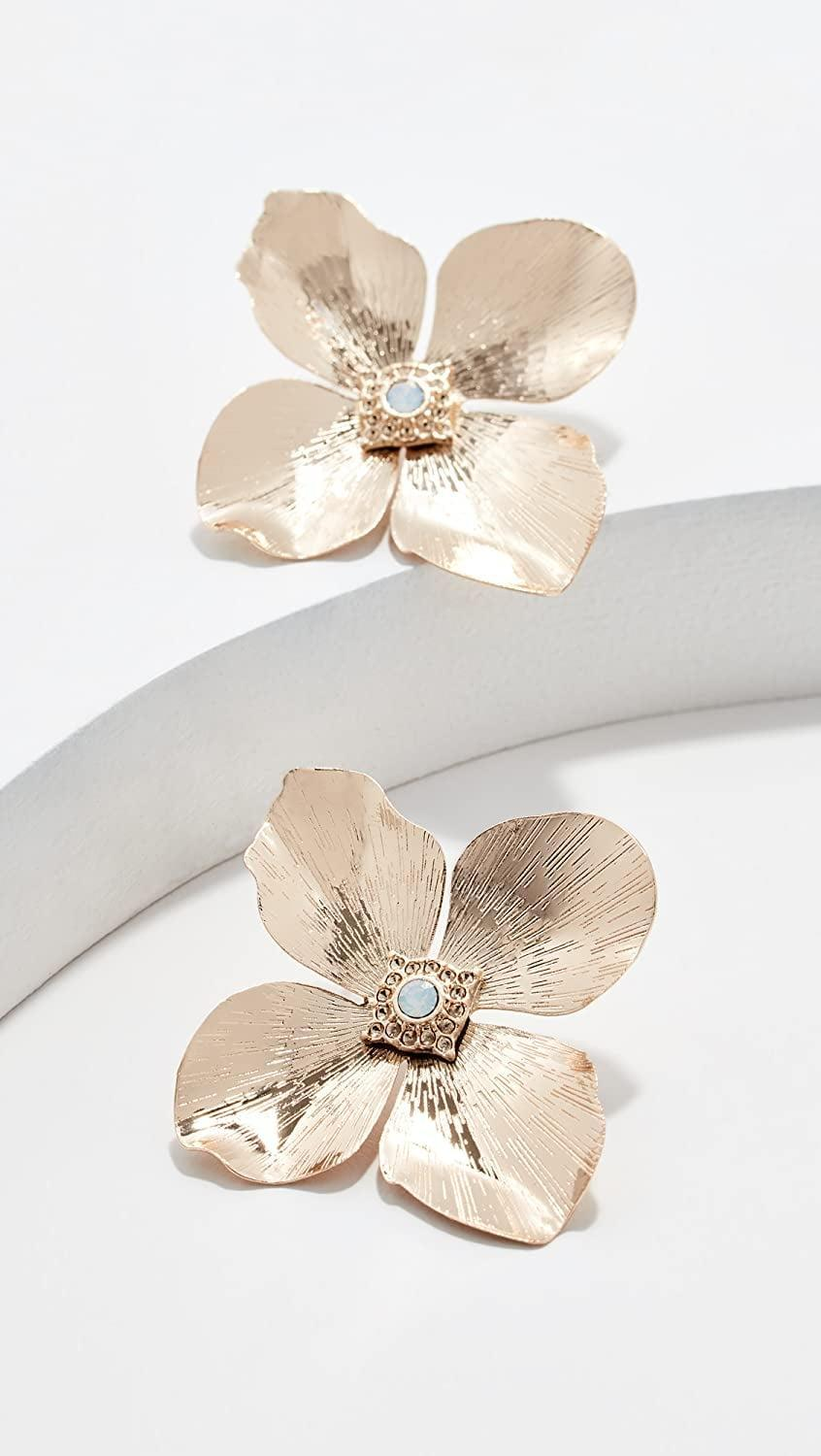 <p>Make a statement with these fun <span>Shashi Blossom Earrings</span> ($48). They also make for great gifts.</p>