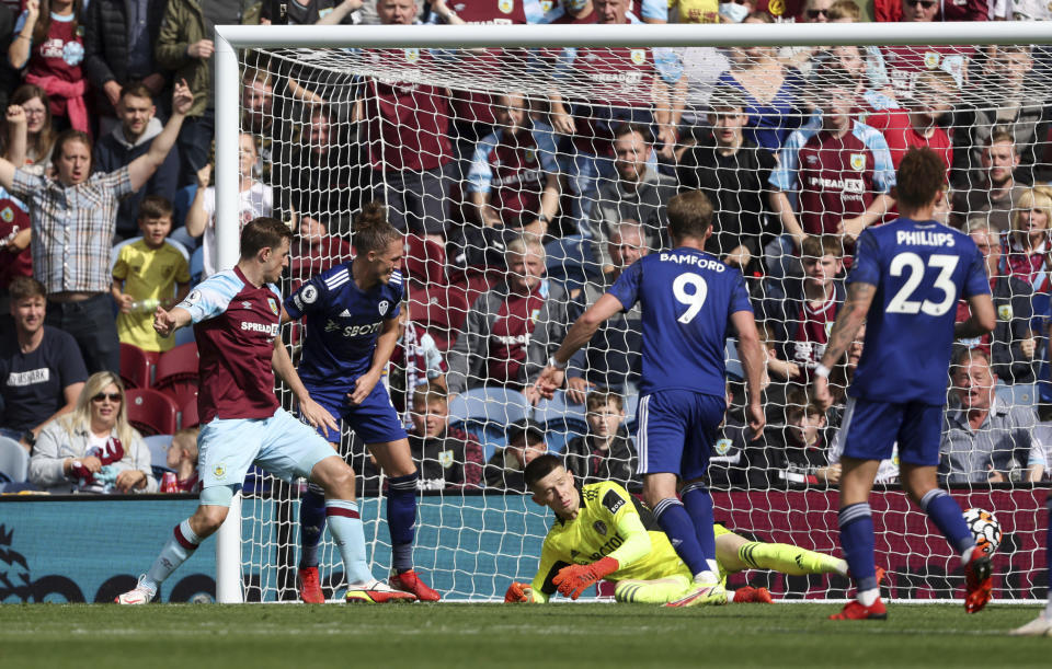 Burnley's Chris Wood scores his side's first goal of the game, during the English Premier League soccer match between Burnley FC and Leeds United, at Turf Moor, in Burnley, England, Sunday Aug. 29, 2021. (Richard Sellers/PA via AP)