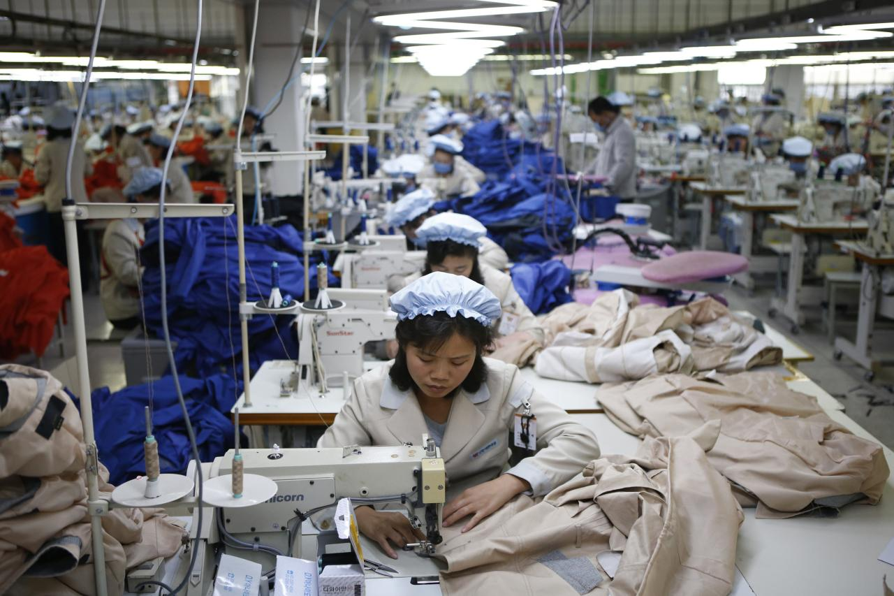 North Korean employees work in a factory of a South Korean company at the Joint Industrial Park in Kaesong industrial zone