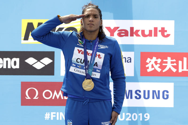 Gold medalist Ana Marcela Cunha of Brazil stands with her medal after the women's 5km open water swim at the World Swimming Championships in Yeosu, South Korea, Wednesday, July 17, 2019. (AP Photo/Mark Schiefelbein)