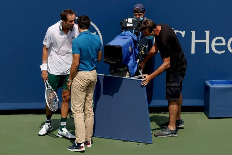 Top-seeded Russian Daniil Medvedev of Russia speaks to chair umpire Nacho Forcadell after colliding with a television camera in his semi-final loss to Andrey Rublev at the ATP Cincinnati Masters