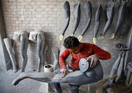 The Wider Image: Mannequins, money and manufacturing