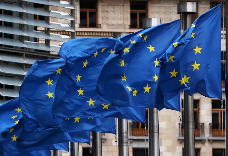 EU flags fly outside the European Commission headquarters in Brussels