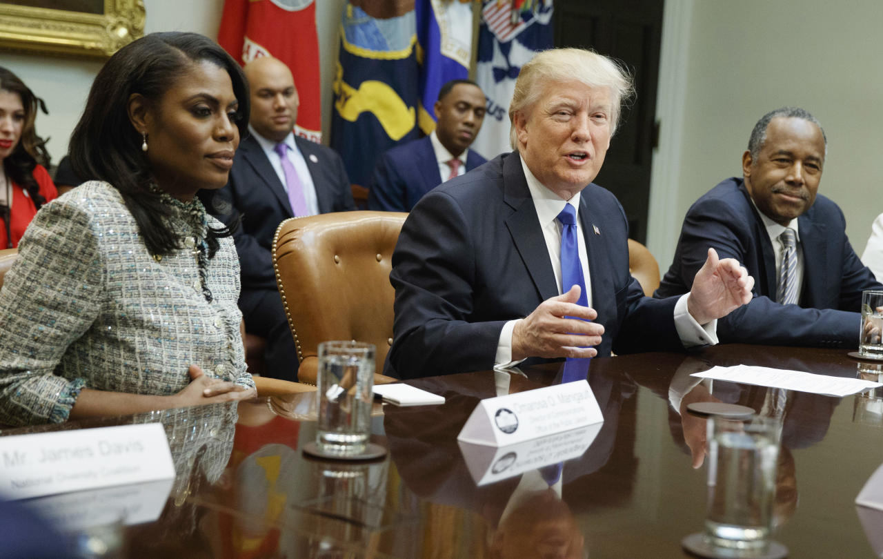"FILE - In this Feb. 1, 2017, file photo, President Donald Trump, center, is flanked by White House staffer Omarosa Manigault Newman, left, and then-Housing and Urban Development Secretary-designate Ben Carson as he speaks during a meeting on African American History Month in the Roosevelt Room of the White House in Washington. Manigault Newman, who was fired in December, released a new book ""Unhinged,"" about her time in the White House. (AP Photo/Evan Vucci, File)"