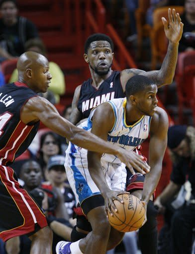 Miami Heat guard Ray Allen, left, slaps the ball away from New Orleans Hornets forward Darius Miller as Udonis Haslem, rear, defends during the first quarter of a preseason NBA basketball game, Friday, Oct. 26, 2012 in Miami. AP Photo/Wilfredo Lee)