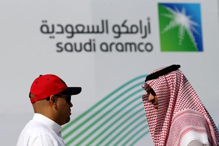 Members of media chat before the start of a press conference by Aramco at the Plaza Conference Center in Dhahran