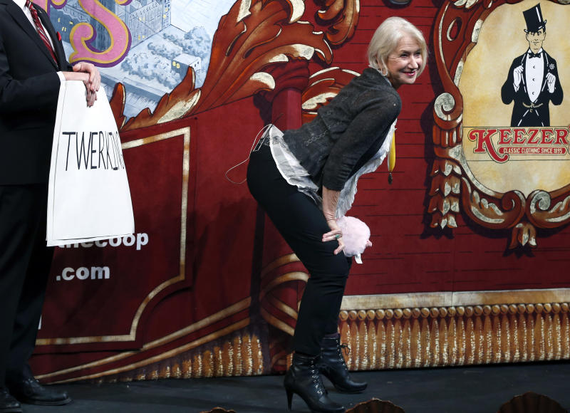 "Actress Helen Mirren ""twerks"" onstage during her roast as woman of the year by Harvard University's Hasty Pudding Theatricals in Cambridge, Mass., Thursday, Jan. 30, 2014. (AP Photo)"