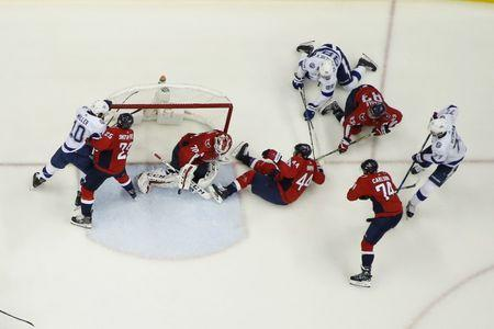 May 21, 2018; Washington, DC, USA; Washington Capitals goaltender Braden Holtby (70) makes a save against the Tampa Bay Lightning in the second period in game six of the Eastern Conference Final in the 2018 Stanley Cup Playoffs at Capital One Arena. The Capitals won 3-0. Mandatory Credit: Geoff Burke-USA TODAY Sports