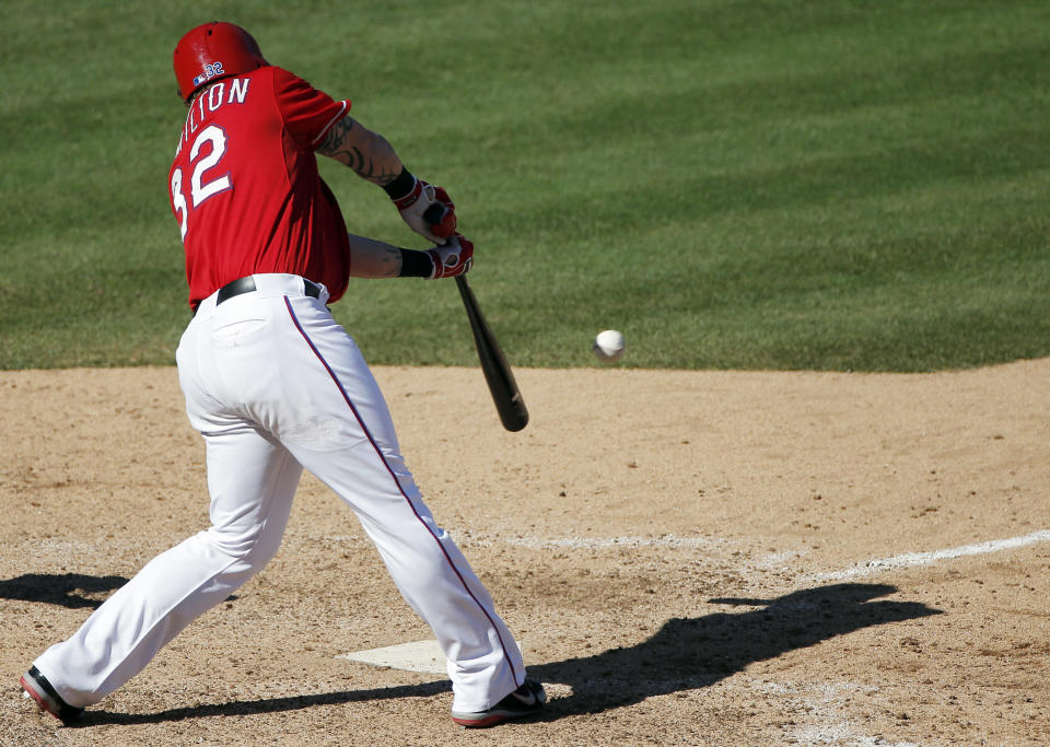 Texas Rangers' Josh Hamilton makes contact for a two-RBI walkoff hit during the ninth inning of a baseball game against the Boston Red Sox, Sunday, May 31, 2015, in Arlington, Texas. Texas won 4-3. (AP Photo/Brandon Wade)