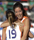 Netherlands' Naomi Van As, right, celebrates her goal against Japan with teammate Ellen Hoog at a women's Field Hockey World Cup match in Rosario, Argentina, Tuesday Sept. 7, 2010. (AP Photo/Eduardo Di Baia)