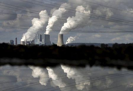 """The coal power plant of German utility RWE Power is reflected in water near the western town of Neurath, Germany in this February 28, 2014 file photo. RWE is expected to report H1 results this week. REUTERS/Ina Fassbender/FilesGLOBAL BUSINESS WEEK AHEAD PACKAGE - SEARCH """"BUSINESS WEEK AHEAD AUG 10"""" FOR ALL IMAGES"""