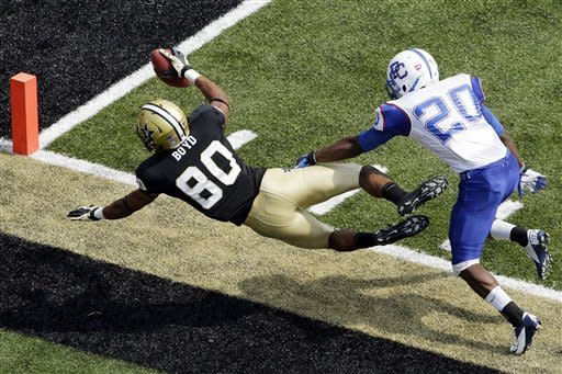 Vanderbilt wide receiver Chris Boyd (80) is knocked out of bounds short of the end zone as he is defended by Presbyterian cornerback Cory White (20) in the first quarter of an NCAA college football game, Saturday, Sept. 15, 2012, in Nashville, Tenn. (AP Photo/Mark Humphrey)