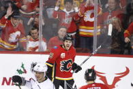 Calgary Flames' Zac Rinaldo, top, celebrates after scoring against the Los Angeles Kings during the second period of an NHL hockey game Saturday, Dec. 7, 2019, in Calgary, Alberta. (Larry MacDougal/The Canadian Press via AP)