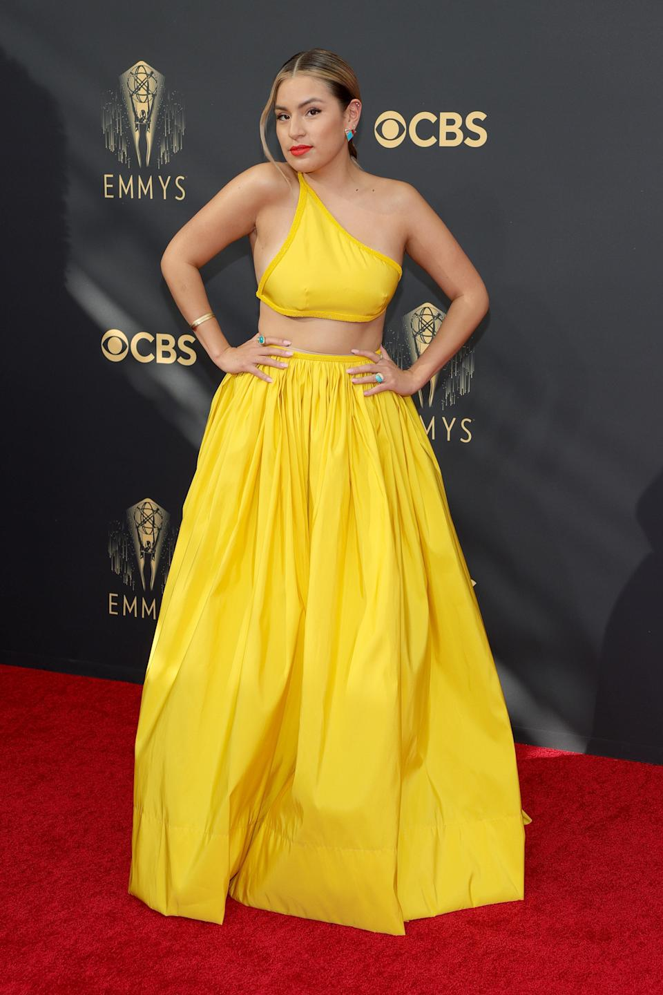 This sunshine yellow crop top gown on Paulina Alexis is so cheerful, as is her orange-red lip.