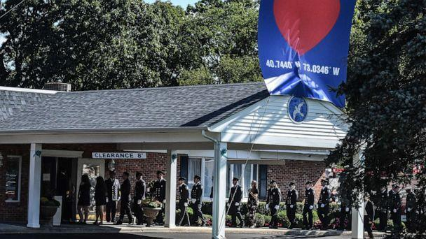 PHOTO: First responders gather at a funeral home to pay respects to Gabby Petito, Sept. 26, 2021, in Holbrook, New York. (Stephanie Keith/Getty Images)
